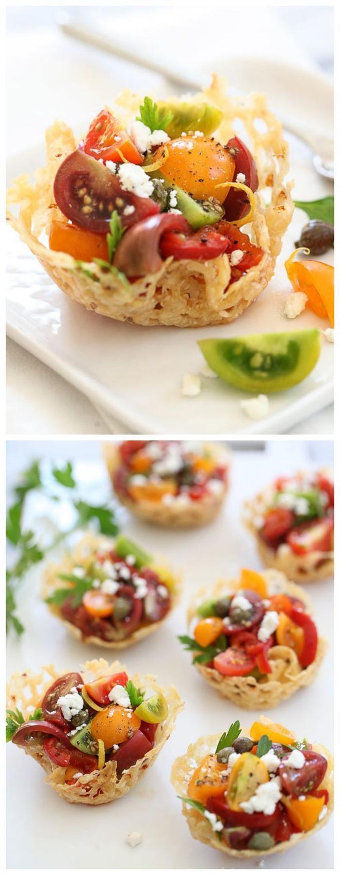 Aperitivo vegetariano con dei cestini di formaggio e verdure come olive e pomodorini