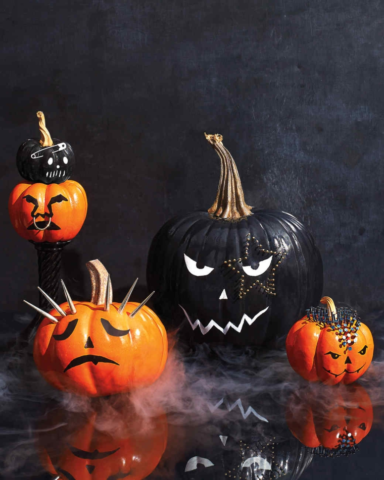 Zucche di Halloween decorate a tema rock con disegni e accessori