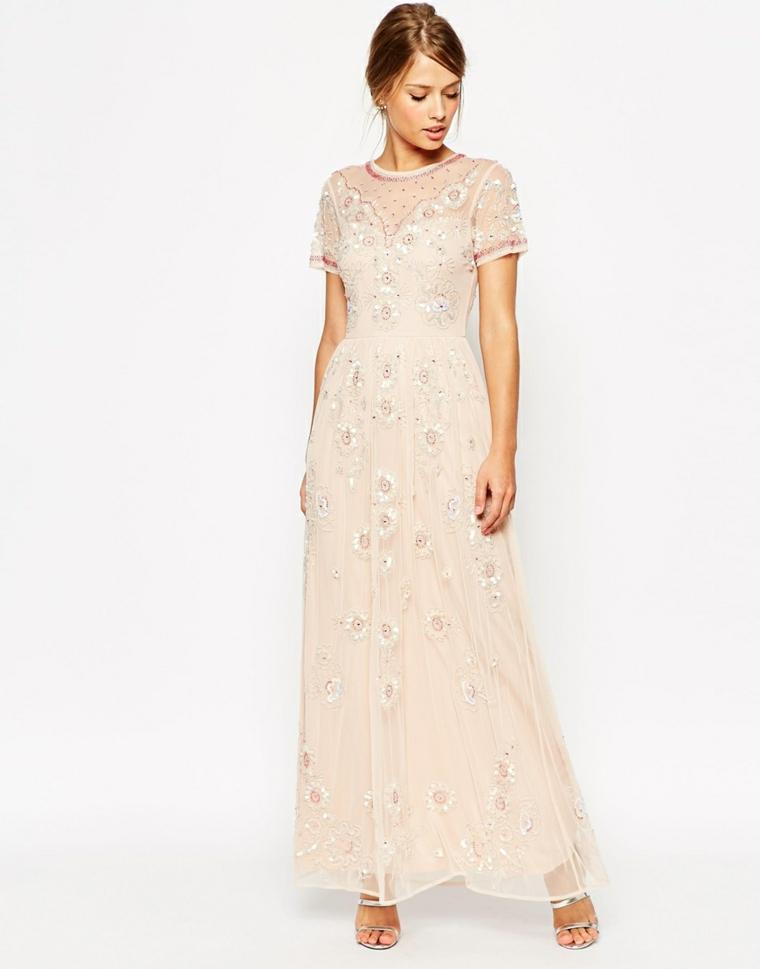 Abiti eleganti economici e un'idea con un vestito di colore rosa con dettagli paillette