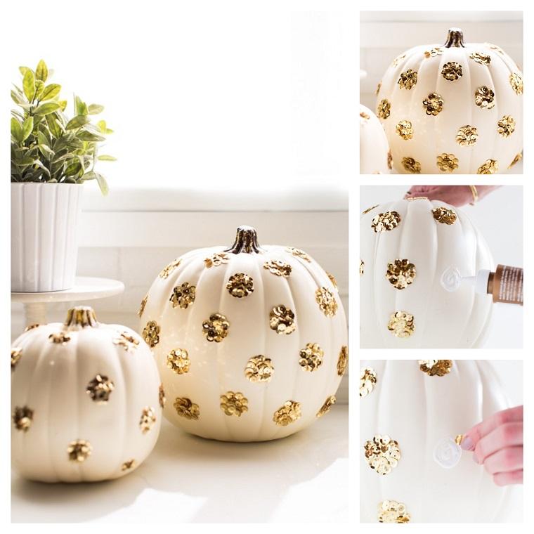 Foto zucche di halloween decorate con paillettes di colore oro incollati