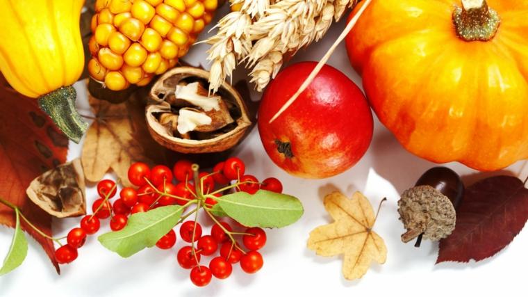 Immagini autunno e un'idea per un centrotavola con noci, frutta e zucche di stagione