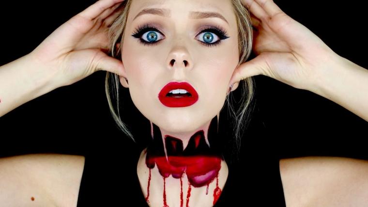 Idea per un trucco ragazza bionda, gola tagliata con pittura rossa come sangue