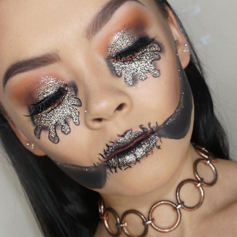 Idea per un trucco strega Halloween con ombretti glitter colore nero e argento