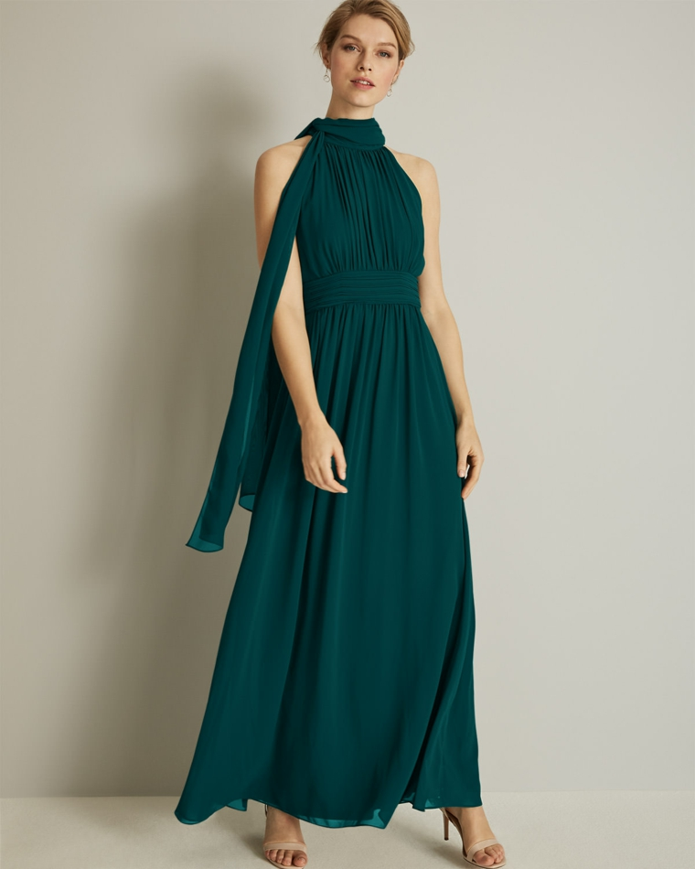 Abito elegante di colore verde plissettato con nodo, abbinamento a scarpe con tacco