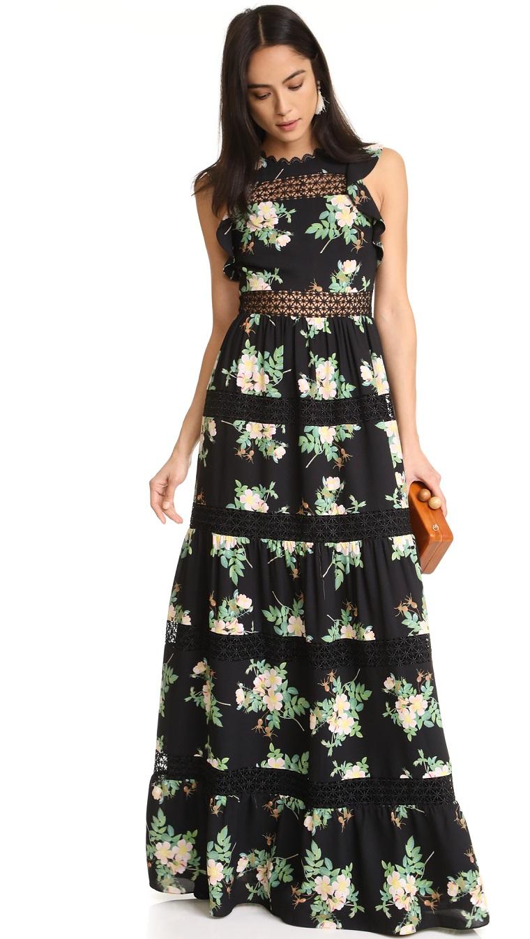 Abiti da sera lunghi firmati, un vestito con stampe floreali di colore nero e pizzo