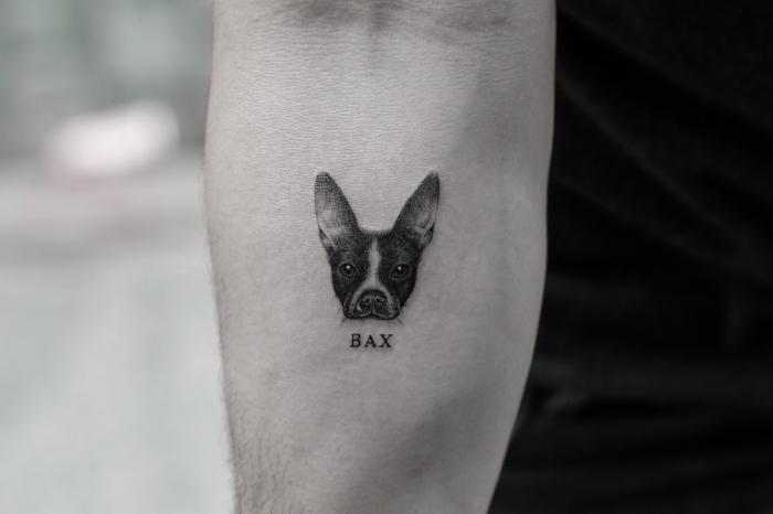 Tatuaggio immagini e un'idea con tattoo sul braccio con la faccia di un cane