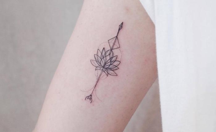 Idea per un tatuaggio mandala con fiore di loto sul braccio di una donna