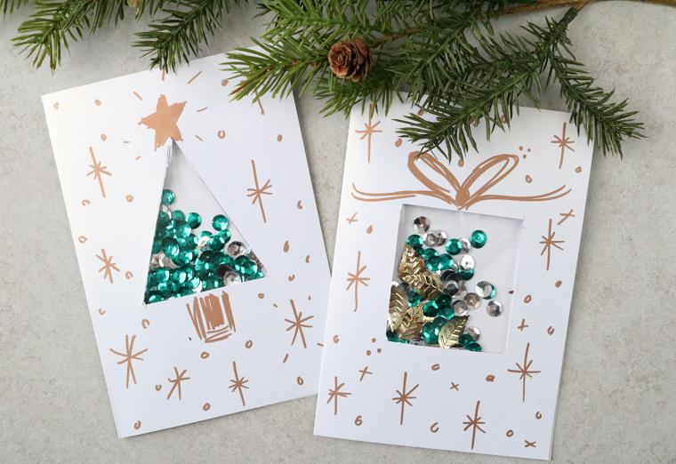 Idea per addobbi natalizi, cartoline disegnate con pennarello e alcuni rametti verdi