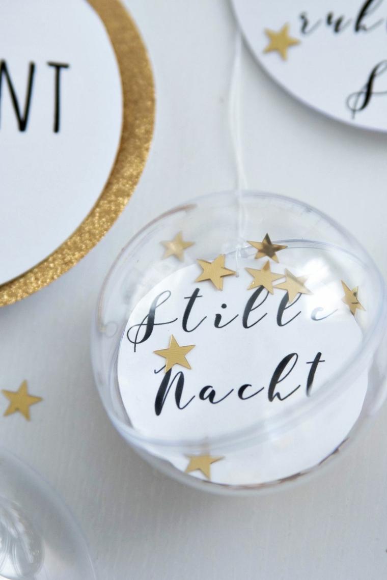 Palline trasparente con stelle e scritta all'interno, filo bianco per appendere le decorazioni