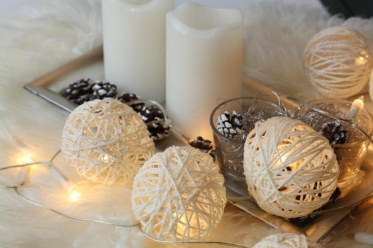 Lavoretti di Natale facili e un'idea con palline di filo di lana e candele come centrotavola