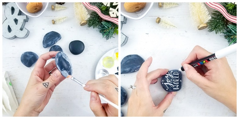 Lavori natalizi fatti a mano con pietre dipinte di nero e poi di bianco, scritte con pennarello indelebile bianco