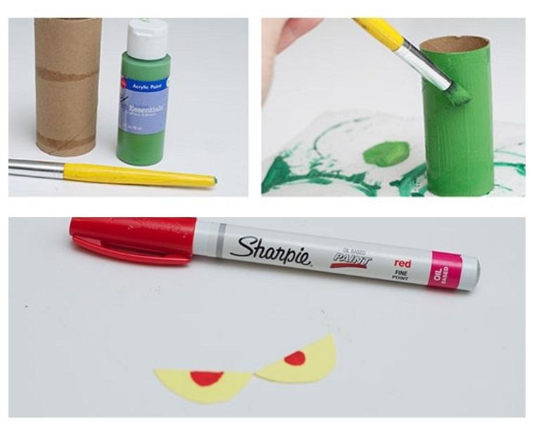 Tutorial per dei lavoretti di Natale per bambini con un rotolo di carta dipinto di verde e un pennarello