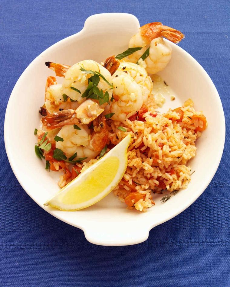 Cena natalizia e un'idea per secondo di gamberetti con risotto e fetta di limone