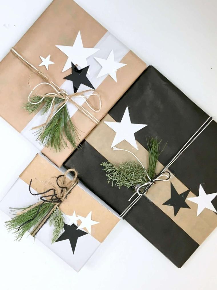 Regali incartati e decorati con fili e stelle attaccate, decorazione con rametti verdi