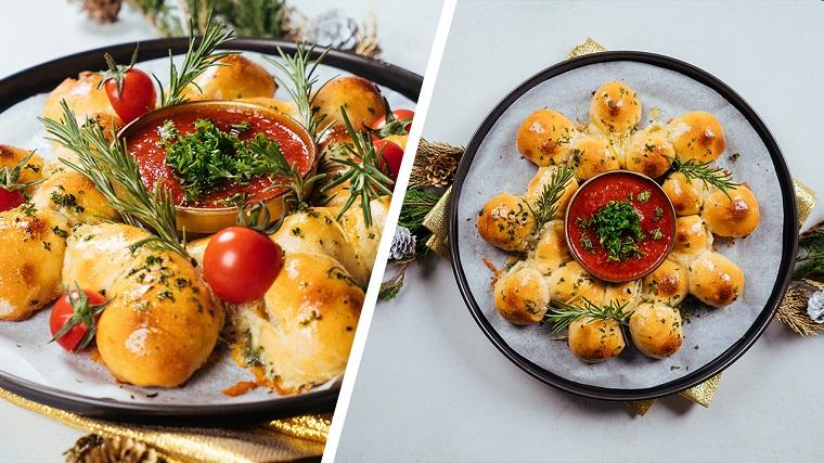 Teglia con panini ripieni di mozzarella, pane decorato con coriandolo fresco, ciotola con salsa di pomodoro