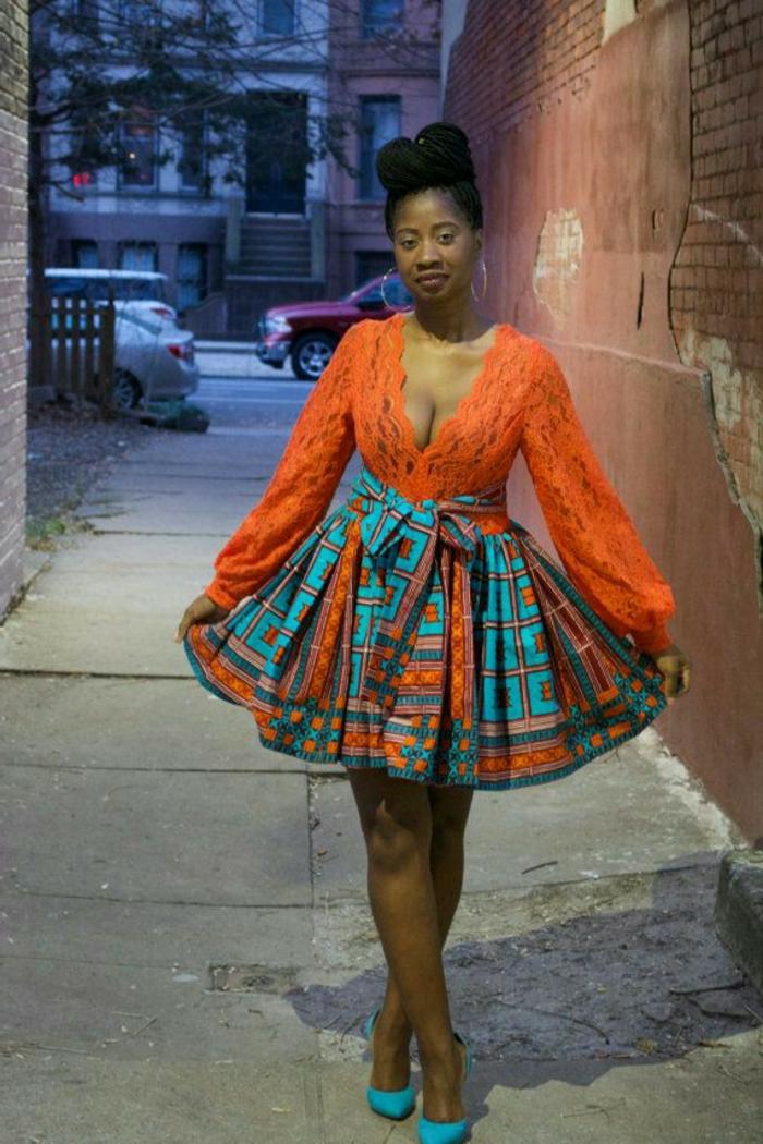 Vestiti africani donne e un'idea di abbigliamento con gonna a ruota e maglietta arancione