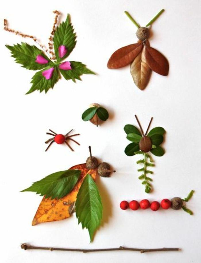 Animaletti e uccelli fati da foglie e bacche rosse