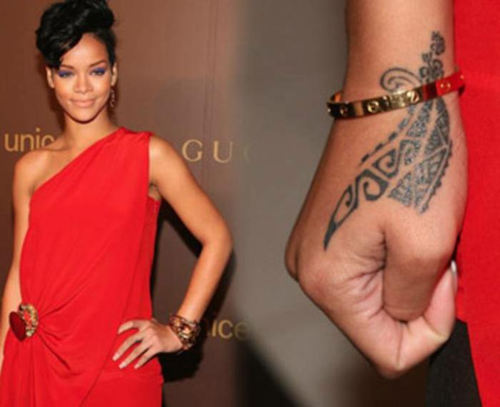 Tatuaggio maori sul braccio, tattoo particolari, Rihanna con un vestito elegante