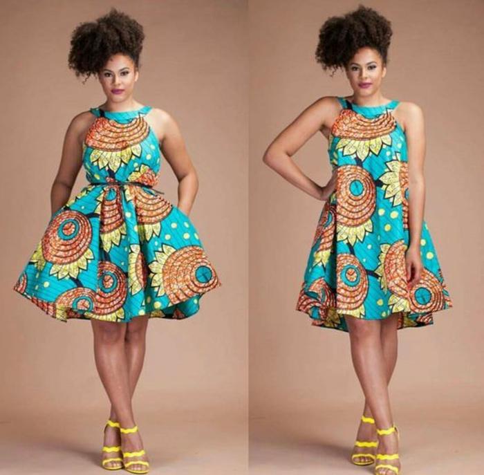 Tessuti africani colorati, abito midi a ruota, due varianti con cintura in vita, ragazza con capelli ricci