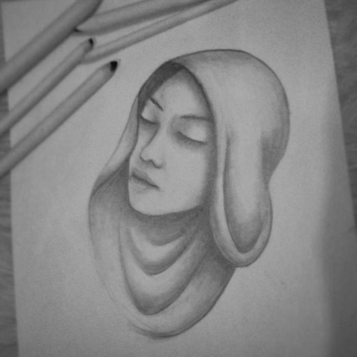 Ritratti a matita, il disegno di una donna, foglio bianco con disegno
