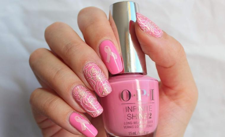 Nail art rosa stilizzata, bottiglietta smalto OPI, unghie con disegni floreali