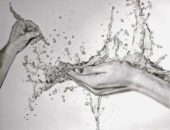 Disegnare con la matita, mani con gocce d'acqua