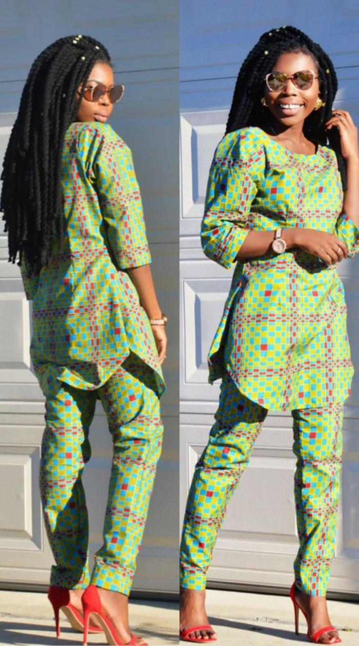 Ragazza africana con trecce, vestiti di colore verde, pantalone abbinato ad una camicia lunga