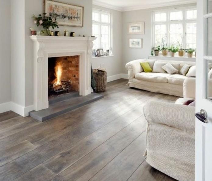 Colori pareti soggiorno, pareti di colore grigio, pavimento in legno, camino a legna