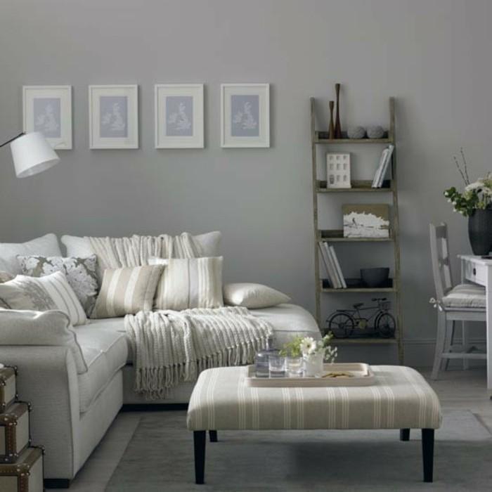 Colori pareti soggiorno, salotto con pareti grigie, divano angolare a tre posti