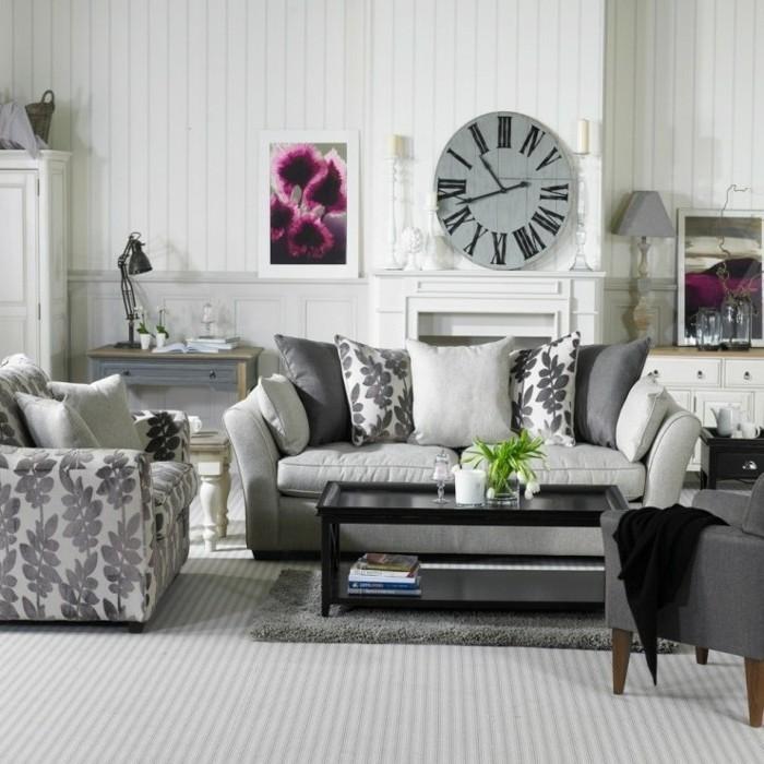 Arredare salotto piccolo, tavolino rettangolare colore nero, decorazioni da parete