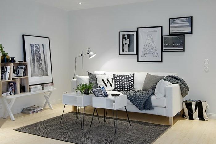Mobili soggiorno moderni, divano bianco con cuscini, tappeto di colore grigio