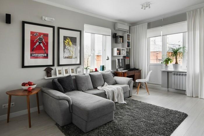Colori per pareti soggiorno. parete di colore grigio, tappeto peloso grigio