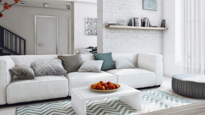 Parete con mattoni a vista, colori per pareti soggiorno, tappeto con disegni geometrici