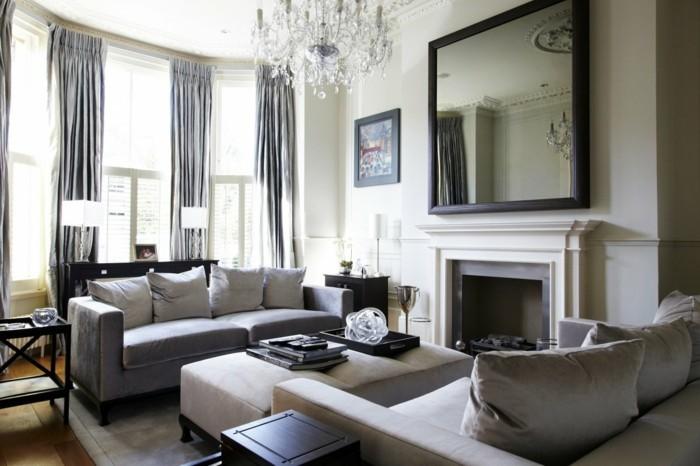 Colori pareti soggiorno, camino tradizionale a legna, divano con cuscini
