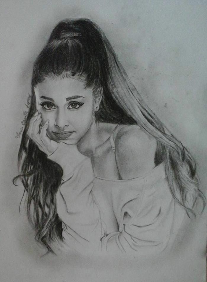 Disegno ragazza, ritratto di Ariana Grande, disegno a matita su foglio bianco