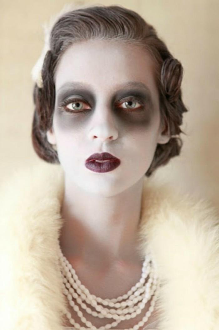 Travestimenti halloween, ragazza con trucco da zombi, ragazza con collana di perle