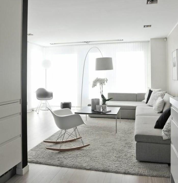 Colori per pareti soggiorno, salotto con tappeto grigio, sedia a dondolo di colore bianco