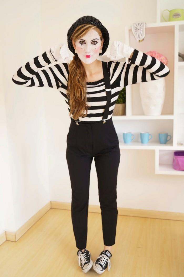 Ragazza vestita come mimo, travestimento semplice per Halloween, viso truccato di bianco