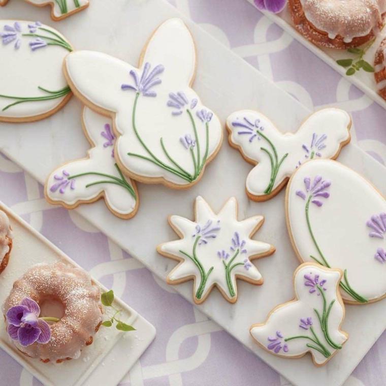 Lavoretti di Pasqua semplici, biscotti a forma di coniglietti, decorazione con glassa bianca