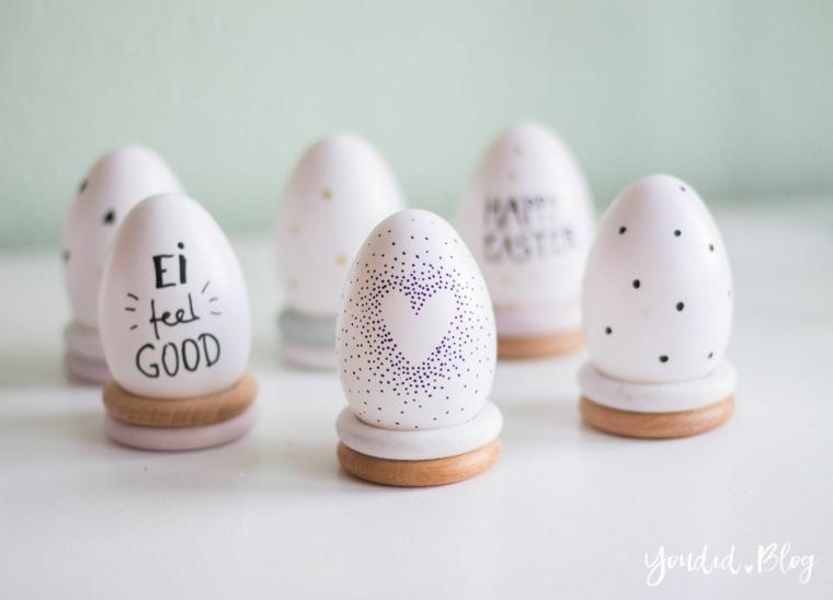 Uova di Pasqua fai da te, uova con disegni, uova di colore bianco