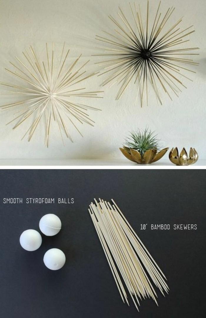 Decorazione con bastoncini di legno, palline bianche