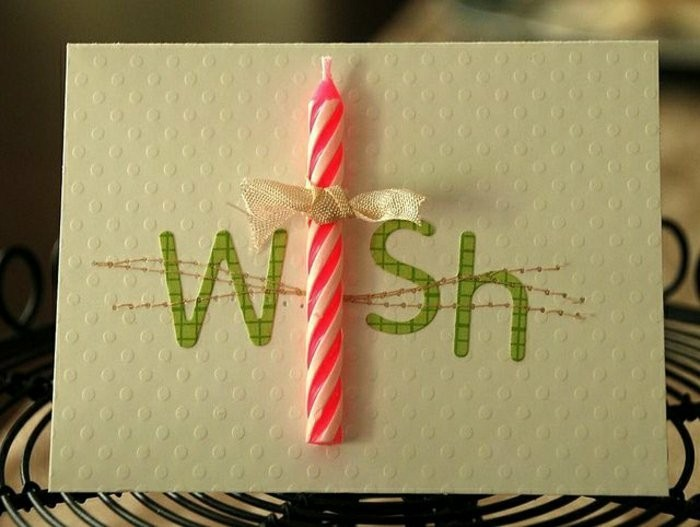 Foglio bianco ruvido, candeline incollate, scritta con washi tape