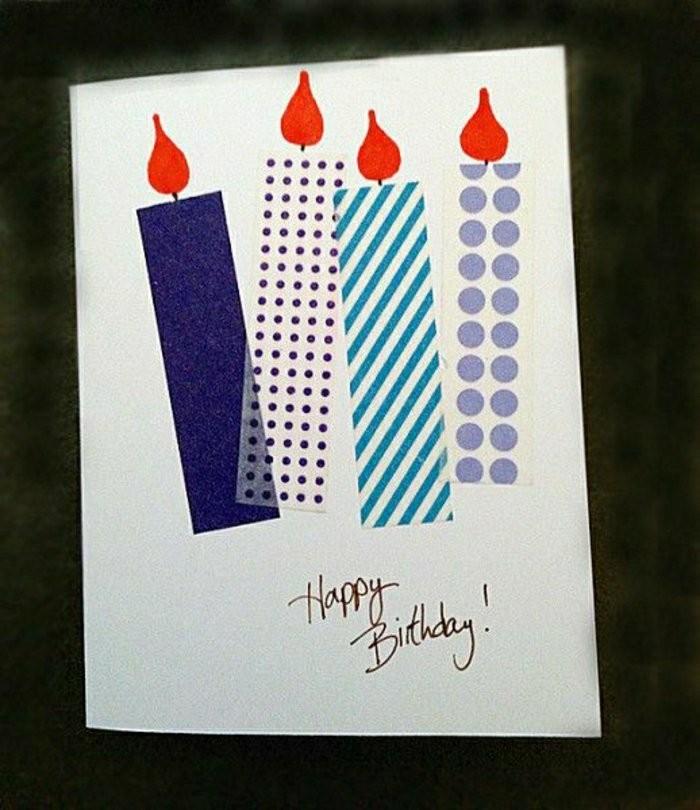 Foglio bianco, candeline con washi tape, scritta buon compleanno