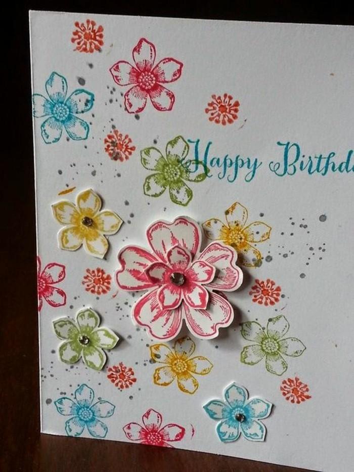 Scritta con pennarello blu, fiori di carta, cartolina tridimensionale