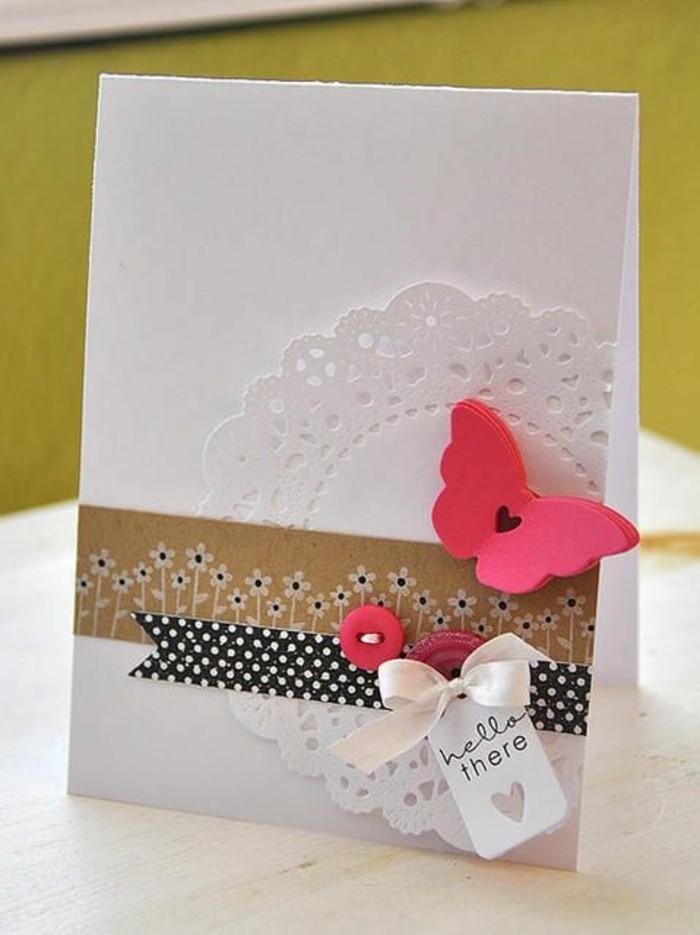 Foglio bianco, disegno con washi tape, farfalla di gomma, biglietto per compleanno