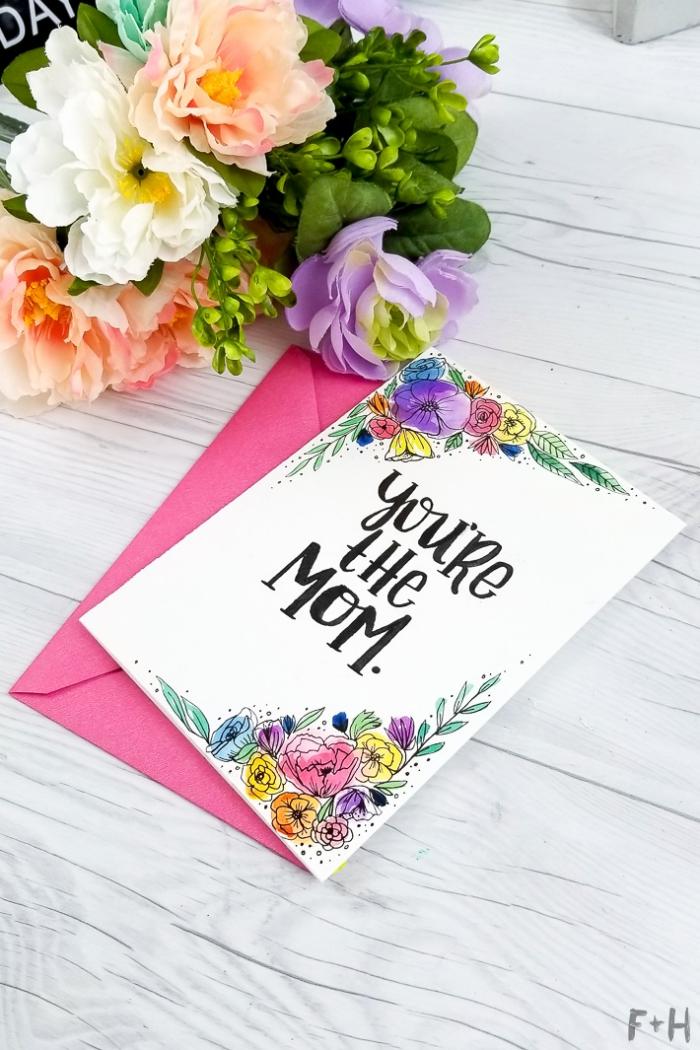 Biglietti auguri fai da te pop up, scritta con pennarello nero, disegni colorati di fiori