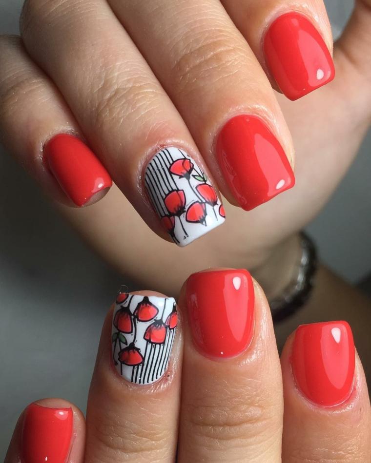 Unghie gel particolati, smalto di colore rosso, disegno di fiori sulle unghie
