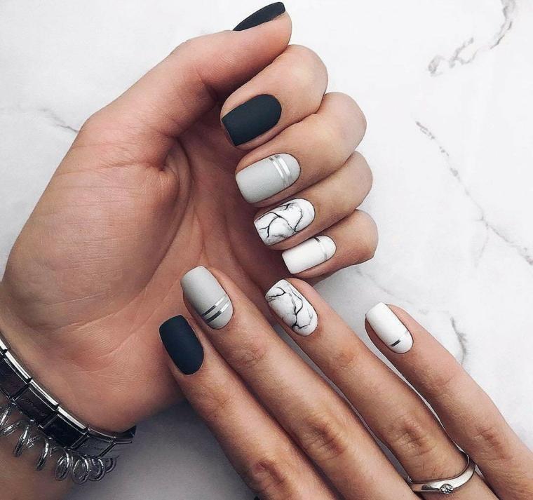 Unghie gel particolati, smalto di colore nero, smalto grigio effetto marmo