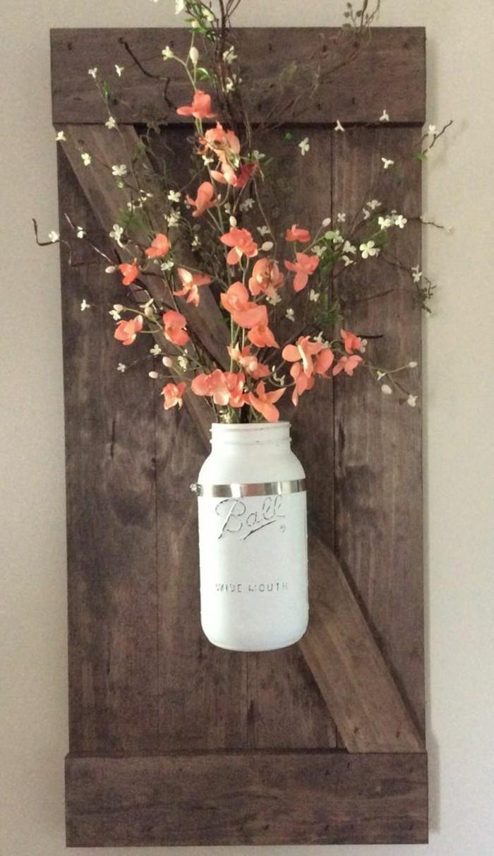Barattolo di vetro incollato alla parete, barattolo con fiori