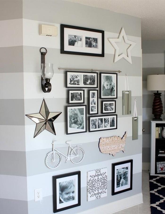 Parete con cornici, parete di colore bianco e grigio